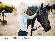 Купить «Female jockey and horse, horseback riding», фото № 30568548, снято 17 сентября 2017 г. (c) Tryapitsyn Sergiy / Фотобанк Лори