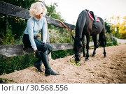 Woman and brown stallion, horseback riding. Стоковое фото, фотограф Tryapitsyn Sergiy / Фотобанк Лори
