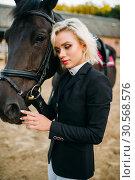 Blonde woman with horse, horseback riding. Стоковое фото, фотограф Tryapitsyn Sergiy / Фотобанк Лори