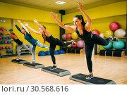 Women group on step aerobic workout. Стоковое фото, фотограф Tryapitsyn Sergiy / Фотобанк Лори
