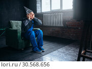 Man in tinfoil cap watch TV, telepathy phobia. Стоковое фото, фотограф Tryapitsyn Sergiy / Фотобанк Лори