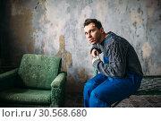 Купить «Crasy man with plasters on face, psycho patient», фото № 30568680, снято 1 октября 2017 г. (c) Tryapitsyn Sergiy / Фотобанк Лори