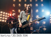 Купить «Musical performers on the stage in night club», фото № 30569104, снято 10 ноября 2017 г. (c) Tryapitsyn Sergiy / Фотобанк Лори