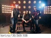 Купить «Musical group poses on the stage in night club», фото № 30569108, снято 10 ноября 2017 г. (c) Tryapitsyn Sergiy / Фотобанк Лори