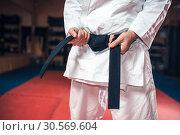 Купить «Male person in white kimono with black belt», фото № 30569604, снято 13 декабря 2017 г. (c) Tryapitsyn Sergiy / Фотобанк Лори