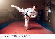 Купить «Martial arts, man in white kimono with black belt», фото № 30569612, снято 13 декабря 2017 г. (c) Tryapitsyn Sergiy / Фотобанк Лори