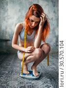 Купить «Thin woman in underwear weighed on a scale», фото № 30570104, снято 10 января 2018 г. (c) Tryapitsyn Sergiy / Фотобанк Лори