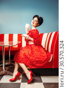 Pin up girl drinks coffee in retro cafe. Стоковое фото, фотограф Tryapitsyn Sergiy / Фотобанк Лори
