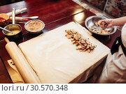 Купить «Male chef sprinkle the dough with cinnamon», фото № 30570348, снято 2 февраля 2018 г. (c) Tryapitsyn Sergiy / Фотобанк Лори