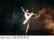 Ballerina in white dress dancing in ballet class. Стоковое фото, фотограф Tryapitsyn Sergiy / Фотобанк Лори
