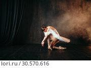 Купить «Grace of ballerina in motion on theatrical stage», фото № 30570616, снято 12 февраля 2018 г. (c) Tryapitsyn Sergiy / Фотобанк Лори