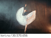 Купить «Ballet dancer in motion on the stage in theatre», фото № 30570656, снято 12 февраля 2018 г. (c) Tryapitsyn Sergiy / Фотобанк Лори