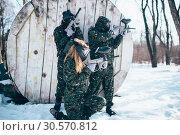 Купить «Paintball team shooting at the enemy, side view», фото № 30570812, снято 25 февраля 2018 г. (c) Tryapitsyn Sergiy / Фотобанк Лори