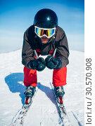 Купить «Skier racing from the mountain, front view», фото № 30570908, снято 6 марта 2018 г. (c) Tryapitsyn Sergiy / Фотобанк Лори
