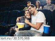 Купить «Smiling couple watching comedy movie in cinema», фото № 30570988, снято 21 марта 2018 г. (c) Tryapitsyn Sergiy / Фотобанк Лори