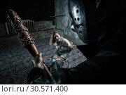 Купить «Serial maniac prepares to kill his female victim», фото № 30571400, снято 19 апреля 2018 г. (c) Tryapitsyn Sergiy / Фотобанк Лори