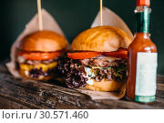 Fresh grilled burgers and ketchup on the table. Стоковое фото, фотограф Tryapitsyn Sergiy / Фотобанк Лори