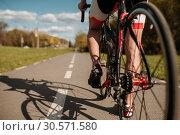 Cyclist on bike path, view from the rear wheel. Стоковое фото, фотограф Tryapitsyn Sergiy / Фотобанк Лори