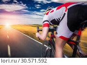 Купить «Cyclist rides on bicycle, speed effect», фото № 30571592, снято 28 апреля 2018 г. (c) Tryapitsyn Sergiy / Фотобанк Лори