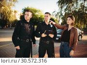Купить «Police officers listerning to testimony of driver», фото № 30572316, снято 6 июня 2018 г. (c) Tryapitsyn Sergiy / Фотобанк Лори