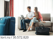 Купить «Couple looks on laptop screen, fees on journey», фото № 30572820, снято 30 июня 2018 г. (c) Tryapitsyn Sergiy / Фотобанк Лори