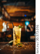 Fresh mojito in a glass and ice on bar counter. Стоковое фото, фотограф Tryapitsyn Sergiy / Фотобанк Лори