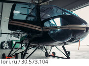 Купить «Small helicopter in hangar, private airline copter», фото № 30573104, снято 19 июля 2018 г. (c) Tryapitsyn Sergiy / Фотобанк Лори