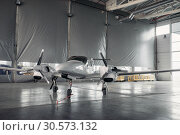Купить «Private turbo-propeller airplane in hangar, nobody», фото № 30573132, снято 19 июля 2018 г. (c) Tryapitsyn Sergiy / Фотобанк Лори