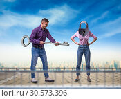Man holds key, woman with keyhole instead of head. Стоковое фото, фотограф Tryapitsyn Sergiy / Фотобанк Лори