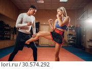 Купить «Female person makes kick in groin, self defense», фото № 30574292, снято 9 сентября 2018 г. (c) Tryapitsyn Sergiy / Фотобанк Лори