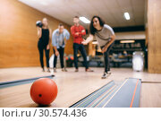 Female bowler throws ball on lane, strike shot. Стоковое фото, фотограф Tryapitsyn Sergiy / Фотобанк Лори