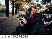 Biker relax after road travel on his chopper. Стоковое фото, фотограф Tryapitsyn Sergiy / Фотобанк Лори