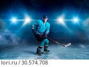One hockey player skating on ice arena (2017 год). Стоковое фото, фотограф Tryapitsyn Sergiy / Фотобанк Лори