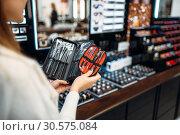 Купить «Customer choosing cosmetics tools in makeup shop», фото № 30575084, снято 30 октября 2018 г. (c) Tryapitsyn Sergiy / Фотобанк Лори