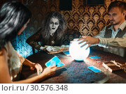 Купить «Young couple and fortune teller, spiritual seance», фото № 30576348, снято 29 января 2019 г. (c) Tryapitsyn Sergiy / Фотобанк Лори