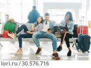 Купить «Group of tourists waiting for departure in airport», фото № 30576716, снято 17 февраля 2019 г. (c) Tryapitsyn Sergiy / Фотобанк Лори