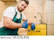 Plumber in uniform showing thumbs up, handyman. Стоковое фото, фотограф Tryapitsyn Sergiy / Фотобанк Лори