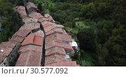 Купить «Aerial view of Castellfollit de la Roca, medieval Catalan hamlet on cliff on autumn day», видеоролик № 30577092, снято 4 ноября 2018 г. (c) Яков Филимонов / Фотобанк Лори