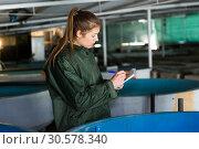 Купить «Female in fish breeding incubator», фото № 30578340, снято 24 августа 2019 г. (c) Яков Филимонов / Фотобанк Лори