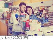 Купить «Couple deciding on best color scheme», фото № 30578508, снято 9 марта 2017 г. (c) Яков Филимонов / Фотобанк Лори