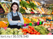 Купить «Female seller displaying assortment», фото № 30578540, снято 18 марта 2017 г. (c) Яков Филимонов / Фотобанк Лори