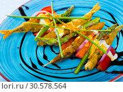 Fried in batter sprats with creamy ginger sauce, tomatoes, balsamic paste. Стоковое фото, фотограф Яков Филимонов / Фотобанк Лори