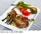Купить «Roasted veal steak with guacamole and baked vegetables», фото № 30578584, снято 27 июня 2018 г. (c) Яков Филимонов / Фотобанк Лори