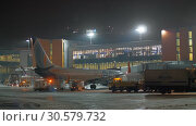 Купить «Aircraft of Flydubai at Terminal E of Sheremetyevo Airport at night, Moscow», видеоролик № 30579732, снято 29 ноября 2017 г. (c) Данил Руденко / Фотобанк Лори