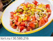 Купить «Appetizing fish salad with canned tuna», фото № 30580216, снято 26 мая 2019 г. (c) Яков Филимонов / Фотобанк Лори
