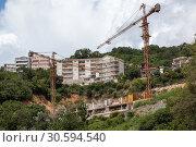 Купить «Строительная площадка зданий на холмах около береговой линии моря. Черногория», фото № 30594540, снято 3 июня 2016 г. (c) Кекяляйнен Андрей / Фотобанк Лори