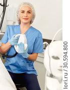 Купить «Professional cosmetician examining face skin of mature woman in clinic of esthetic cosmetology», фото № 30594800, снято 14 марта 2019 г. (c) Яков Филимонов / Фотобанк Лори