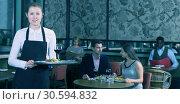 Polite waitress holding tray with dishes. Стоковое фото, фотограф Яков Филимонов / Фотобанк Лори
