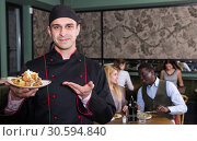 Купить «Proud chef offering dish for tasting», фото № 30594840, снято 7 марта 2018 г. (c) Яков Филимонов / Фотобанк Лори