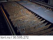Купить «Metal rust conveyor in old printing studio», фото № 30595272, снято 23 января 2019 г. (c) Pavel Biryukov / Фотобанк Лори